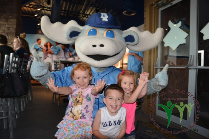 Young children in front of a moose mascot