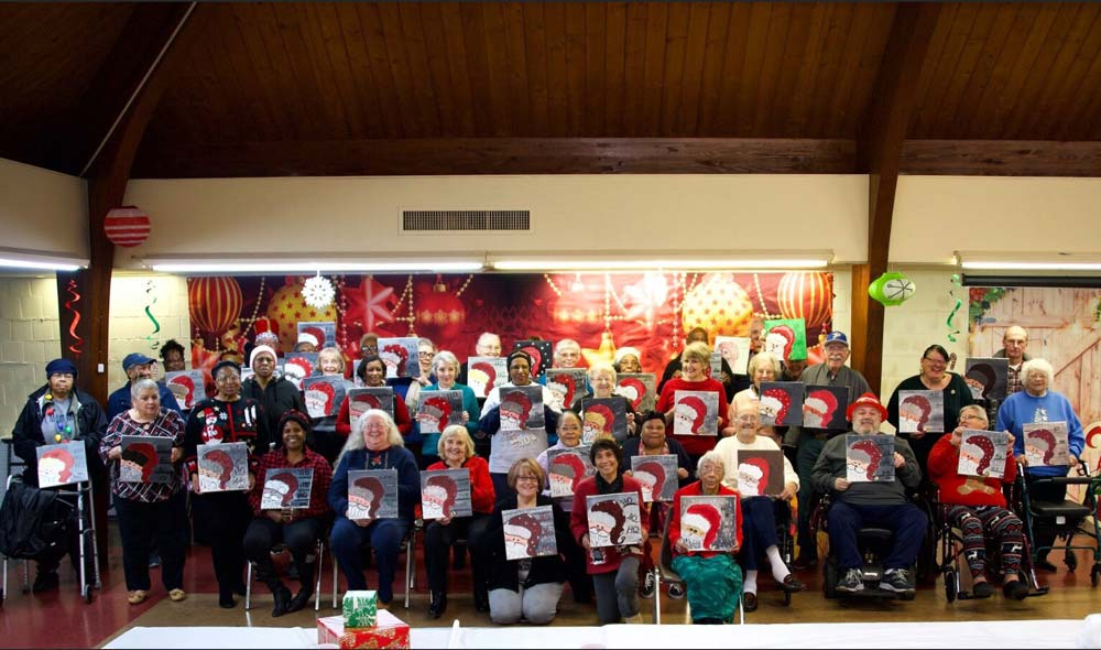 Group of seniors showing off their santa paintings for Cocoa and Colors 2019