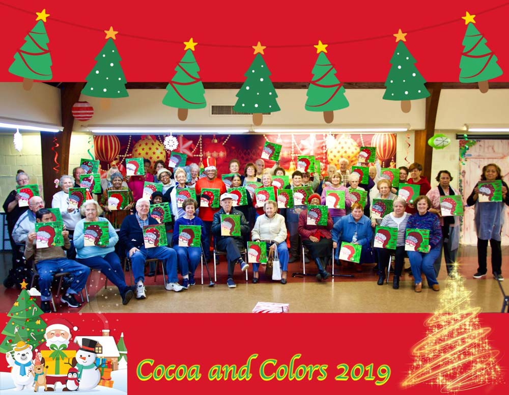 Cocoa and Colors 2019 group photo of seniors showing their Santa paintings